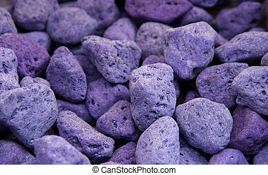 lava and pumice tinted purple and blue used as perfume for...