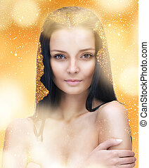 beautiful woman with long hair in golden dust