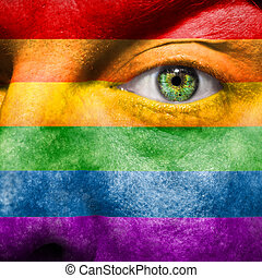 Rainbow Flag painted on face to show gay pride support