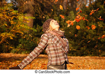 Young woman enjoying autumn