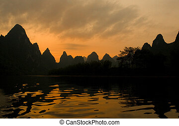 Li River in Yangshuo - Mountains and river at sunset in...