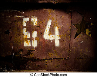 Stencil number - Old style stencil numbers painted on rusty...