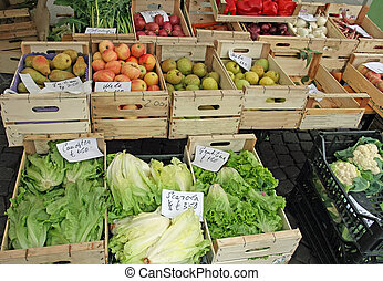 fruit crates on sale vegetable market with vegetables - many...