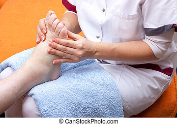 Nurse treats a patients foot - female Nurse treats a...