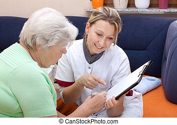 female doctor makes an checkup - female doctor with an...