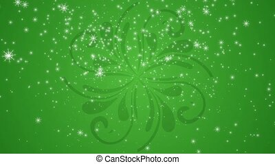 Snowflakes are falling against a green flourish pattern...