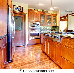 Luxury cherry wood kitchen interior with hardwood.