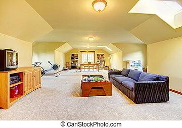 Large play room with Tv, sport and games. Home interior.