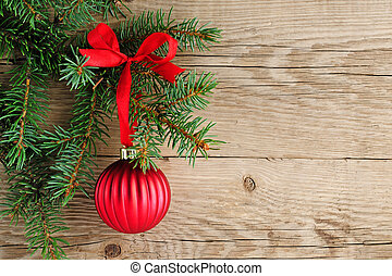 Spruce branches with christmas decoration on wooden...