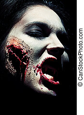 laceration smile - Close-up of a bloodthirsty zombi over...