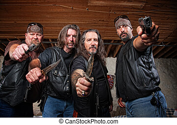 Four Mean Gang Members in Leather Jackets - Four tough...