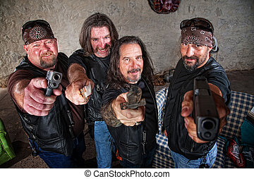 Smiling Gang Members with Weapons - Smiling group of...