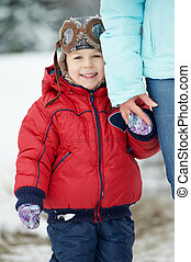 Happy young child son at winter