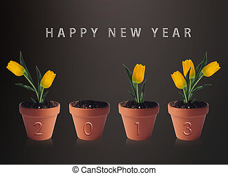 Happy new year 2013, conceptual image pots with yellow tulip...