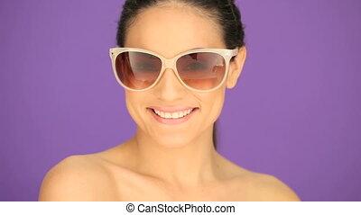 Smiling brunette in sunglasses