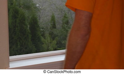 Reducing Home Dust and Allergies - Hand dusting a window...