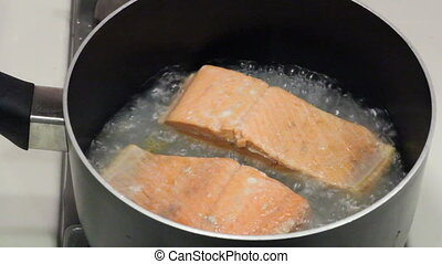 Salmon Fillets Poaching - Two wild sockeye salmon fillets...