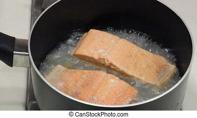 Salmon Fillets Poaching - Two wild sockeye salmon fillets...