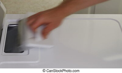 Cleaning Dryer Lint Trap - Male hand cleaning the clothes...