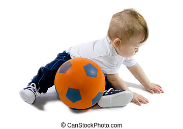 Baby sitting on floor with football ball - Little baby...