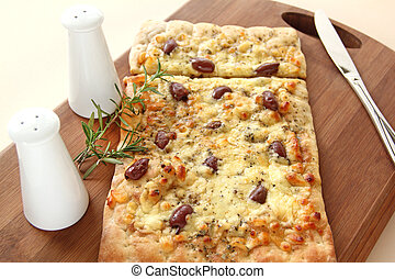 Gourmet Pizza - Rectangular gourmet pizza with cheese and...