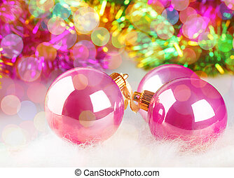 Greeting card with Christmas balls on colorful background