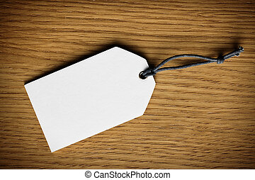 blank price tag label on wooden background - the blank price...