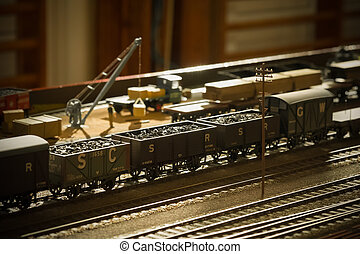 coal train - vintage toned model coal train backlit by...