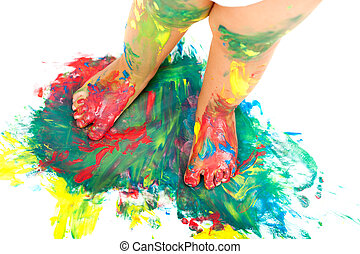 Babies feet on colorful mosaic paint. - Close up of babies...