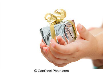 Babies hands holding small present - Macro close up of...