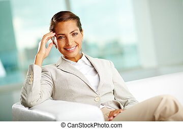 White collar worker - Portrait of successful female sitting...