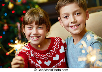 Kids on Christmas eve - Portrait of happy siblings with...