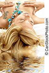 dreaming blonde in spa - bright portrait of dreaming topless...