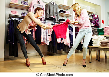 Greedy girls - Image of two greedy girls fighting for red...