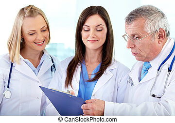 Planning work - Portrait of successful medical workers...
