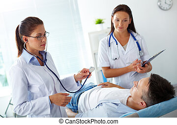 Healthcare - Portrait of two female doctors looking at...