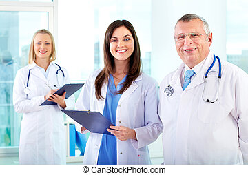 Medical staff - Portrait of successful therapeutists looking...