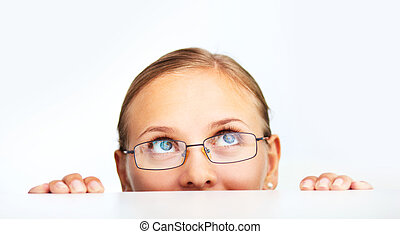 Peeking - Face of smart businesswoman in eyeglasses looking...
