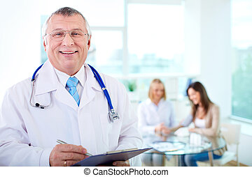 Male doctor - Portrait of smiling male practitioner looking...
