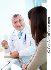 Prescribing vitamins - Portrait of confident practitioner...