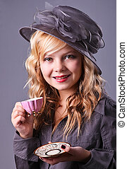 Beautiful young girl at a tea party - Retro styled blonde...