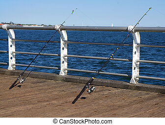 fishing rods - two fishing rods in summer