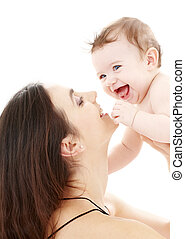 laughing blue-eyed baby playing with mom
