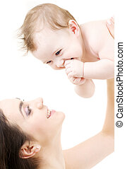 laughing blue-eyed baby playing with mom - picture of happy...