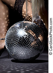 fishnet stockings and disco ball - party dancer girl in...