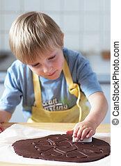 Cookie Cutter - cute boy cutting chocolate cookies