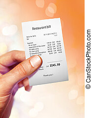 Restaurant bill for a large sum of money on hand