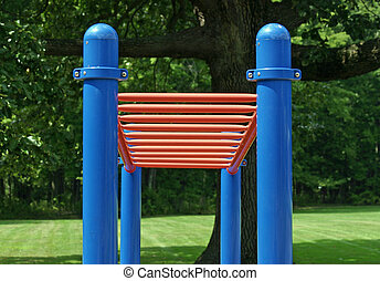 Playground Bars - A set of red bars in an empty playground