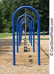 Swingset - A blue swingset in a neighborhood park