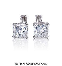 Diamond earrings isolated on white.
